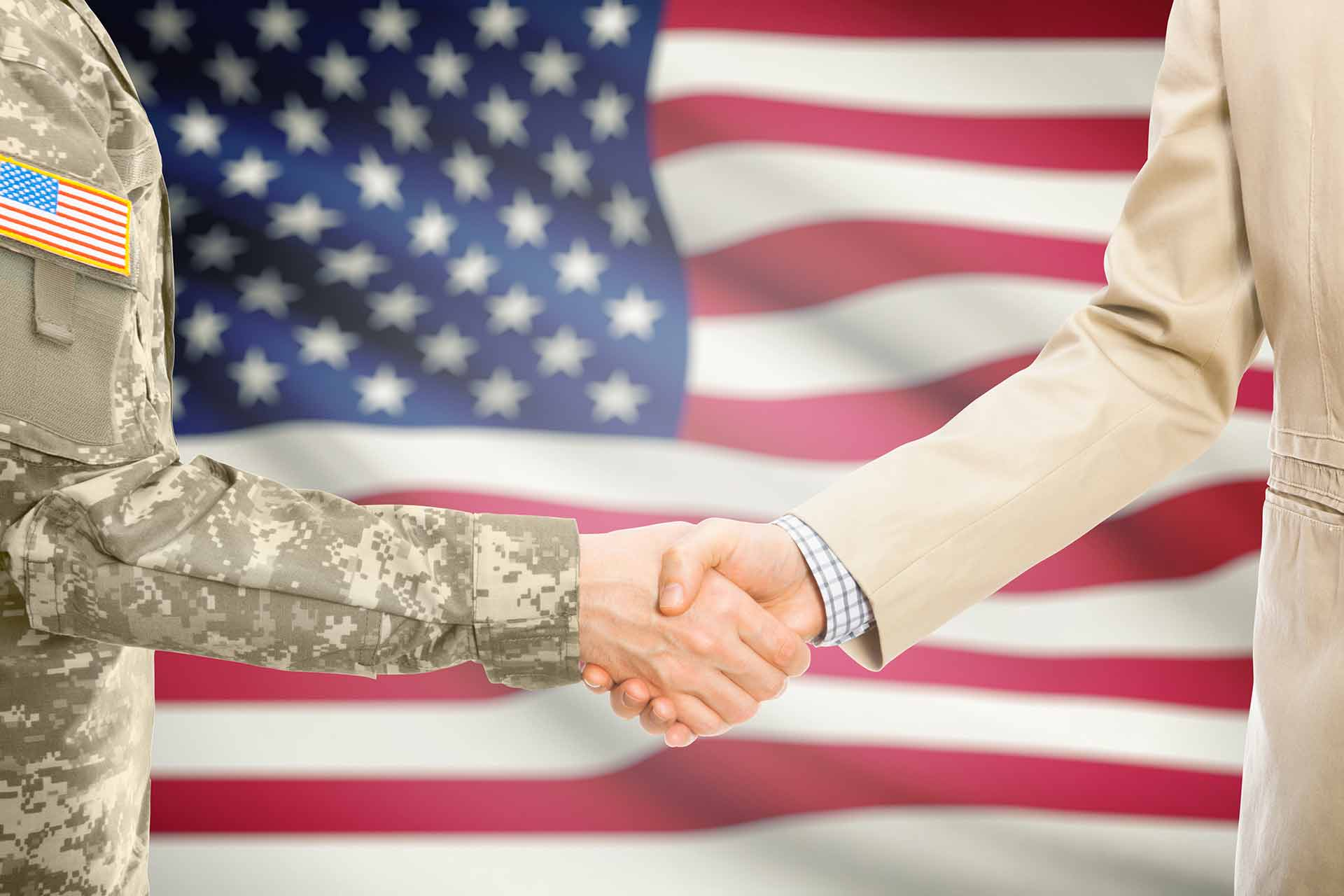 Image of veteran and business owner shaking hands